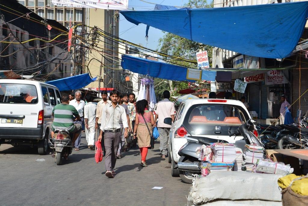 A woman walking in busy streets of Delhi