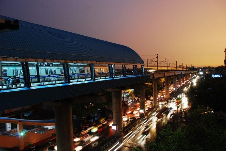 a-metro-station-and-streams-of-vehicles-beneath