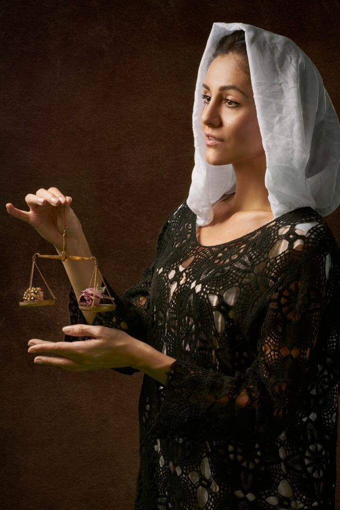 woman-in-black-dress-holding-balance-scale