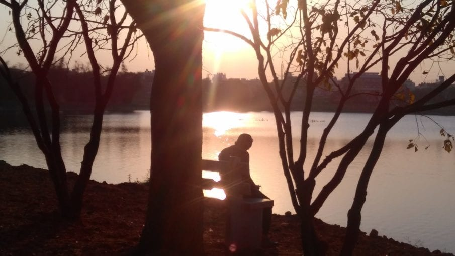 sitting next to lake