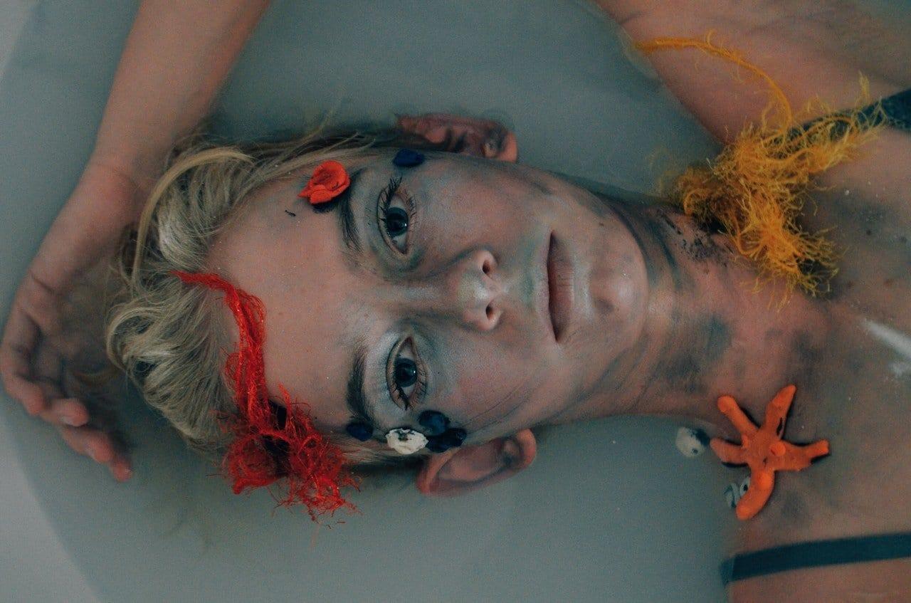 glaring-woman-lying-in-body-of-water-