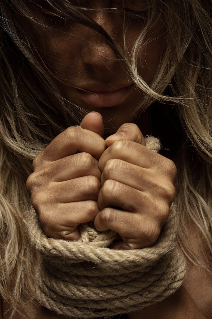 close-up-photo-of-woman-with-her-hands-tied-with-rope-